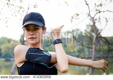 Healthy Sport Asian Young Women Stretching Body Warm Up Before Workout Outdoor. Female In Sportswear