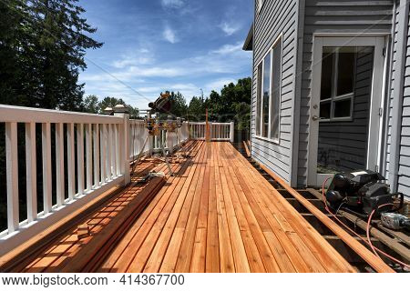 Complete Home Outdoor Deck Remodel With New Red Cedar Wood Planks Being Installed