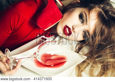 Fashion Drunk Girl. Sensual Elegant Glamour Young Woman With Glass And Poored Red Wine