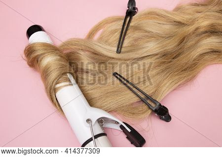Curling Blonde Hair On A Large Diameter Curling Iron On A Pink Background. Curl Care, Hair Styling,