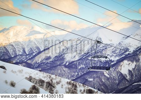 Gudauri Six Seat Blue Chair Lift With Caucasus Mountains Background. Blank Space Ski Resort Closure