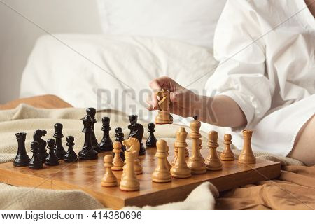 Chess Player Woman Learns Chess Opening By Playing With Himself. White Horse One Step Forward. Chess