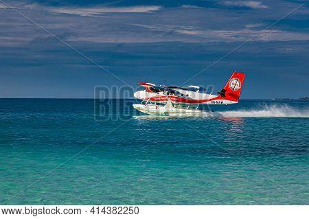 Ari Atoll, Maldives - May.05.2018: Exotic Scene With Seaplane On Maldives Sea Landing. Vacation Or H