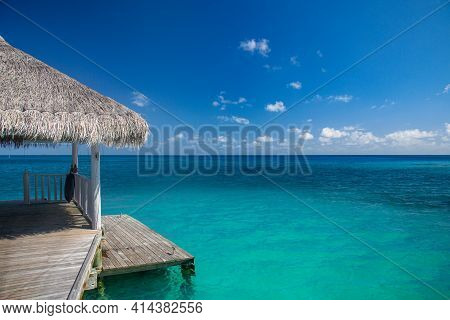 Long Wooden Jetty With Water Bungalows At Maldives. Luxury Summer Travel And Vacation Destination. A