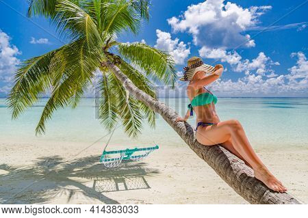 Bikini Model On Tropical Island Beach With Palm Tree And Sea Horizon, Shore. Sexy Woman On Vacation