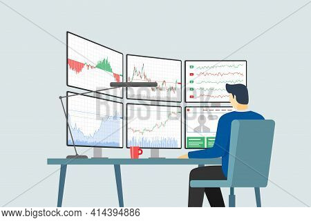 Stock Market Trader At Workplace Looking At Multiple Computer Screens With Financial Charts, Diagram
