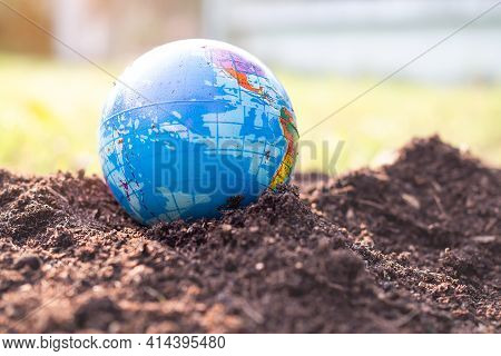 Earth On Fertile Soil With Dry Ground Blured. Saving Environment Earth Day, Conservation, Forest Day