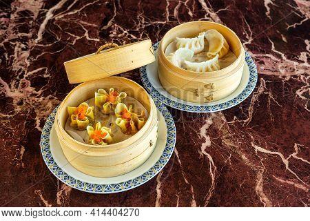 Japanese Gyoza Fried Dumplings In Box. Dimsum In The Steam Basket . Chinese Dimsum Bamboo Steamer