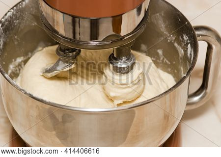 Kneading The Dough In An Electric Mixer. Making Dough At Home For Baking In A Mixer