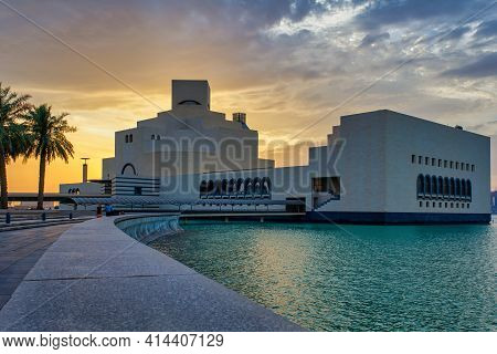 Doha, Qatar -march 27 2021: Museum Of Islamic Art , Doha, Qatar  Exterior View At Sunset With Clouds