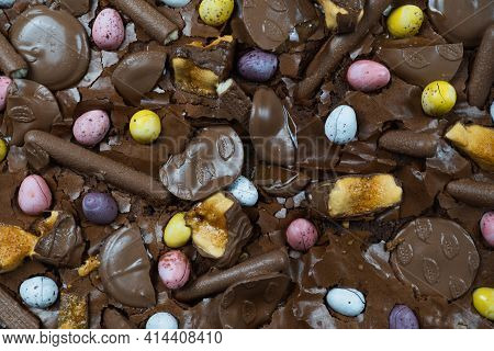 Home Baking Easter Concept. Brownie With Chocolate Bars, Mini Easter Eggs And Biscuits Baked In. Cho