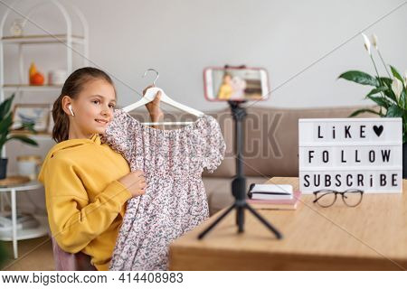 Happy Young Blogger Girl Sharing Her Opinion About Fashion Clothes With Followers, Shooting Video Wi