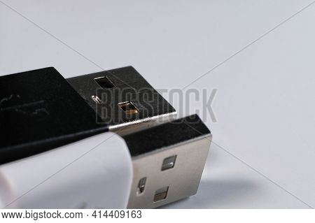 Close Up Of One Black And One White Usb Cable