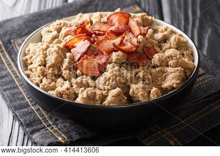 Rustic Style Ajdovi Zganci Slovenian Buckwheat Porridge Served With Cracklings Close-up In A Bowl On