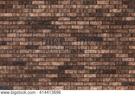 Surface Of The Wall Is Made Of Decorative Clinker Brick In Brown Color.