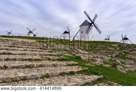 Stone Steps And Pathway Leading To The Historic White Windmills Of La Mancha Near The Town Of Campo