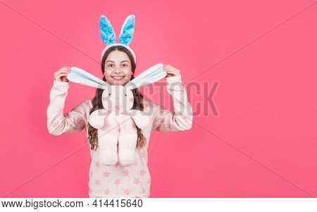 Happy Easter Teen Girl In Bunny Rabbit Ears And Pajamas Play With Toy, Copy Space, Easter