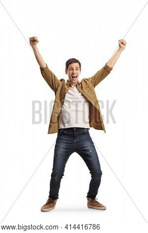 Full length portrait of an excited young man cheering with happiness isolated on white background