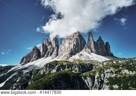 Mountainous Landscape With Clouds In Three Peaks Nature Park In Italian Dolomite Alps, Sesto Dolomit
