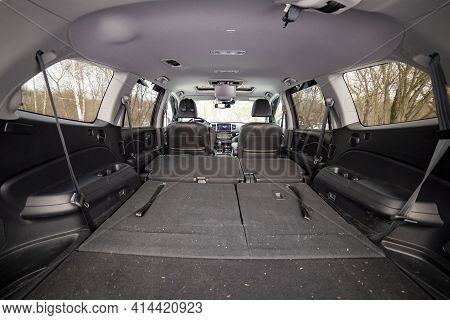 Rear View Open Car Trunk With Folded Passenger Seats. Large Empty Flat Flor Car Trunk Close Up. Huge