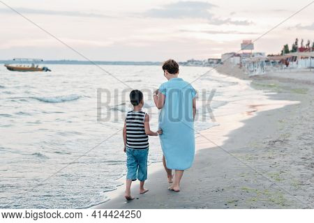 Summer Vacation At Sea. Boy And Senior Woman At Seaside. Grandmother With Grandchild Are Resting On