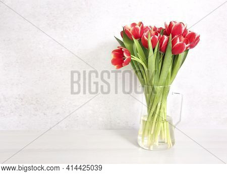 Red Tulips Flower Bouquet In Glass Vase On Table Empty Copy Space.fresh Flowers On White Background.