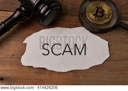 Judge Gavel, Golden Bitcoin And Torn Paper Written With Scam.