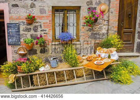 Rustic Setting With Traditional Agricultural Tools And Typical Tuscan Food, Italian Countryside