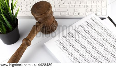 Work Desk Of Contemporary Lawyer. Lawyer Office Concept. Judge Gavel Near Computer Keyboard And Char