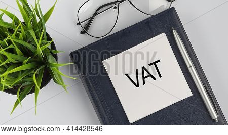 Stickers On Notebook Text Vat With Pen And Glasses On The White Background