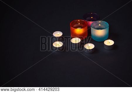 Candles On Dark Background. View With Copy Space.
