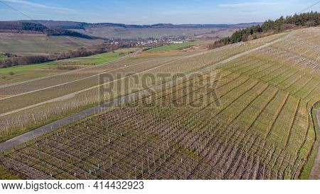 Aerial View Of The River Moselle Valley With Vineyards And The Village Osann-monzel In The Backgroun