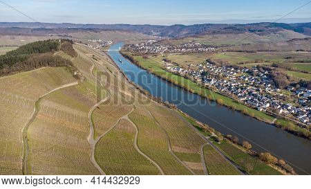 Aerial View Of The River Moselle Valley With Vineyards And The Villages Brauneberg And Muelheim