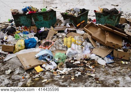 A Pile Of Garbage In A Landfill, Containers And An Abundance Of Waste, Trash And Pollution Of Plasti