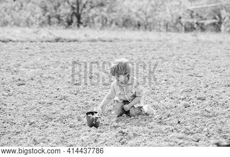 Organic Farm. Planet Protection. Earth Day. New Life. Summer Farm. Happy Child Gardener. Plant Nurse