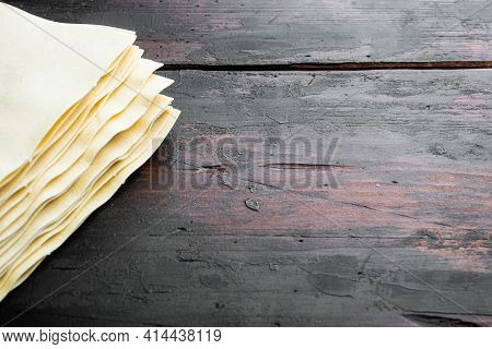Lasagna Dough Sheets Set, On Old Dark  Wooden Table Background, With Copy Space For Text
