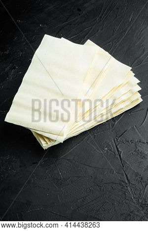 Uncooked Lasagna Sheets Set, On Black Stone Background, With Copy Space For Text