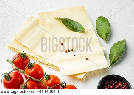 Lasagna Dough Sheets Set, With Seasoning And Herb, On White Stone  Background
