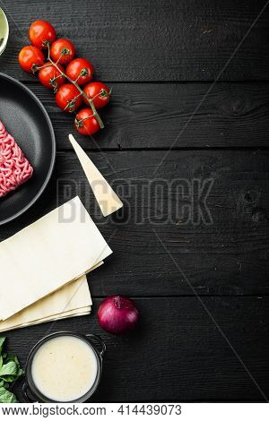 Ingredients For The Preparation Of Lasagna. Tomatoes, Sauce, Bechamel Set, On Black Wooden Table Bac