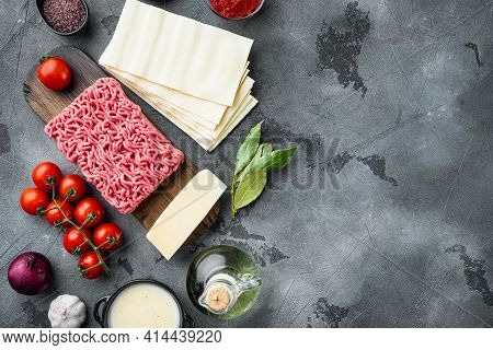 Different Ingredients For Lasagna Set, On Gray Stone Background, Top View, Flat Lay, With Copy Space