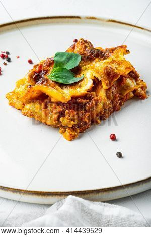 Italian Lasagne With Tomato Bolognese Sauce And Mince Beef Meat Set, On Plate, On White Stone  Backg