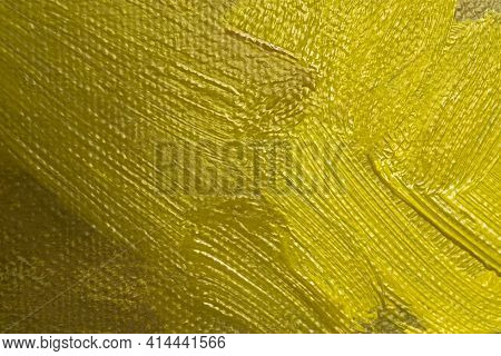 Abstract Background With Brown And Yellow Oil Paint On Canvas. Close-up Of Brushstrokes In The Paint
