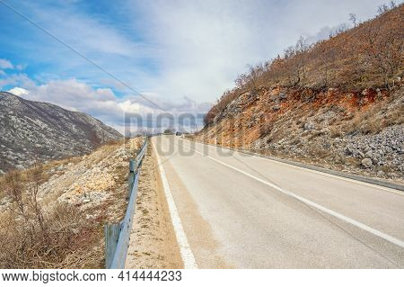 Balkan Road Trip.  Mountain Landscape With Road In Dinaric Alps. Asphalted Two-lane Road With Dividi