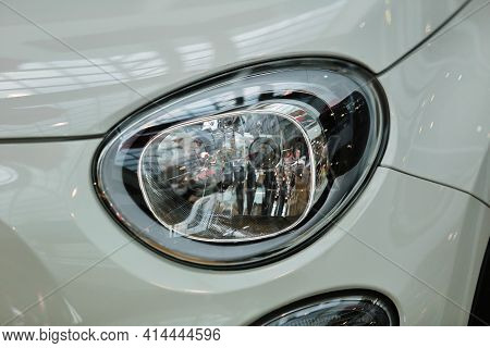 Headlights, White Car. Headlights Of A New White Car On A Bokeh Background. Headlight With Led Bulbs