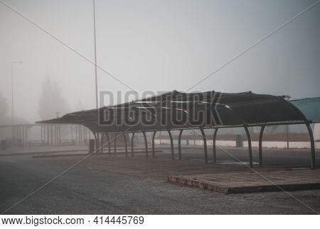 View Of A Foggy Empty Covered Car Parking Area Inside Of A Typical Filling Station Zone Of Portugal;
