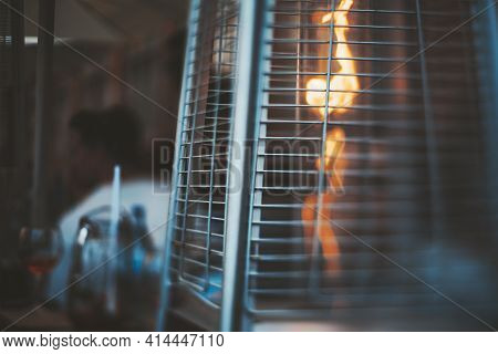 A True Tilt-shift Photo Of A Street Gas Heater For A Patio With A Flame Of Fire Inside, With A Selec