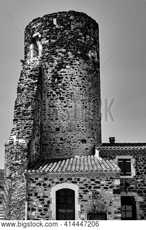 Stone Medieval Tower And Historic Buildings  In The City Of Saint-vincent In France, Monochrome