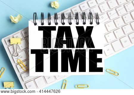 Tax Time. Time To Restart. Text On White Notepad Paper On White Keyboard