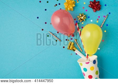 Top View Photo Of Birthday Composition Blast From Paper Dotted Cup Of Tinsel Sparkles Red Yellow Gol