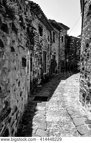 A Street With A Medieval, Stone Buildings In The City Of Saint-vincent In France, Monochrome